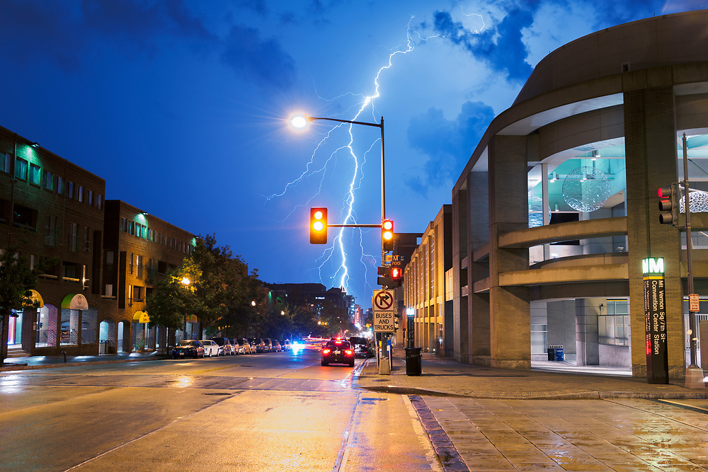 A bolt of lightning strikes the ground near downtown, as seen from 7th and M street outside the Convention Center metro station.