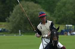 HRH The PRINCE OF WALES playing polo at the Kuoni World Class Polo Day held at Hurtwood Park Polo Club, Surrey on 29th May 2005.<br />
