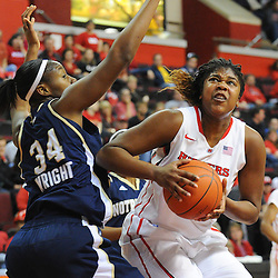 Rutgers Scarlet Knights forward/center Monique Oliver (34) goes for a basket against Notre Dame Fighting Irish forward Markisha Wright (34) during second half NCAA Big East women's basketball action between Notre Dame and Rutgers at the Louis Brown Athletic Center. Notre Dame defeated Rutgers 71-41.