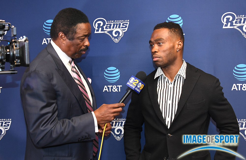 Apr 5, 2018; Thousand Oaks, CA, USA: CBS Los Angeles KCBS/KCAL broadcaster Jim Hill (left) interviews Los Angeles Rams receiver Brandin Cooks at press conference at Cal Lutheran.
