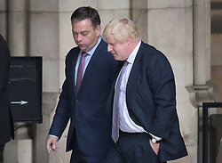 © Licensed to London News Pictures. 27/06/2016. London, UK.  Boris Johnson is seen at Parliament talking to MP Nigel Adams . Labour Party Leader Jeremy Corbyn is making new appointments to his shadow cabinet after a number of resignations. Photo credit: Peter Macdiarmid/LNP