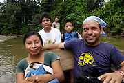 Ecuador, May 10 2010: Jorge, Chino (and wife and son) and Jorge travelled on the canoe to the bridge. Images from Huaorani EcoLodge. Copyright 2010 Peter Horrell