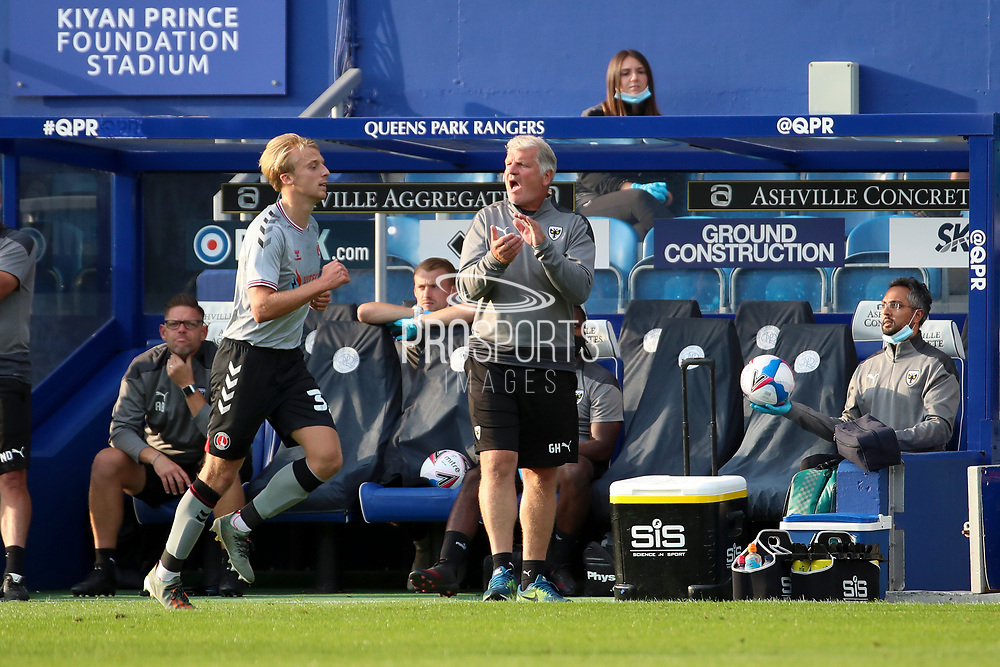 AFC Wimbledon manager Glyn Hodges in home dugout and clapping during the EFL Trophy Group O match between AFC Wimbledon and Charlton Athletic at the Kiyan Prince Foundation Stadium, London, England on 1 September 2020.