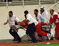 03/03/04 - ABU DHABI - UAE - Under 23 - U23 - PRE OLYMPIC GAMES - U.A.E Vs. BAHRAIN<br /> Here Min. BAHRAIN Player N*9 ALI SAEED AZIZ. its goling directly to the ambulance in bad conditions.<br />  Gabriel Piko/ Digitalsport