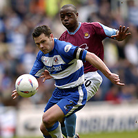 Photo: Richard Lane.<br /> Reading v West Ham United. Nationwide Division One. 03/04/2004.<br /> Graeme Murty is challenged by Nigel Reo-Coker.