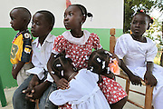 Youngsters from the surrounding countryside around Carrefour gather in front of the Saint Roch clinic to see if they will be sponsored by foster parents back in the US, who for approximately $25/month will send the youngsters through school.  With no public education, this is the only way that the children of the mountain will get schooling.