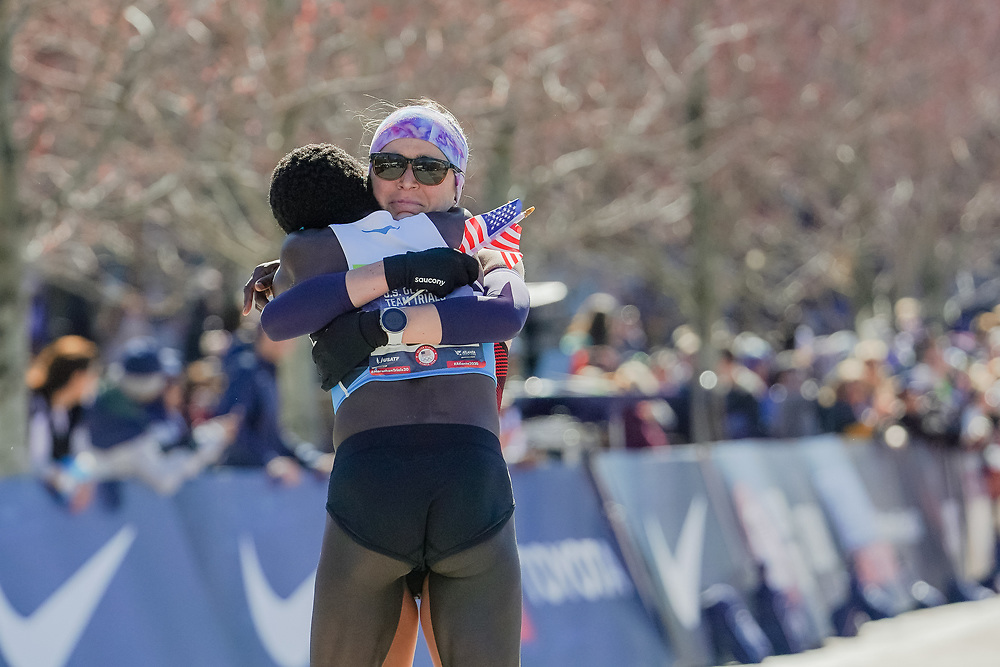 Molly Seidel (in sunglasses) embraces Aliphine Tuliamuk after finishing the 2020 U.S. Olympic marathon trials in Atlanta on Saturday, Feb. 20, 2020. Tuliamuk finished first and Seidel came in second. Photo by Kevin D. Liles for The New York Times