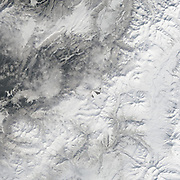 """Five Volcanoes Erupting at Once<br /> <br /> Remote. Cold. Rugged. Those three adjectives capture the essence of Russia's Kamchatka Peninsula. Another word—perhaps more applicable than anywhere else on Earth—is """"fiery.""""<br /> Of the roughly 1,550 volcanoes that have erupted in the recent geologic past, 113 are found on Kamchatka. Forty Kamchatkan volcanoes are """"active,"""" either erupting now or capable of erupting on short notice. The Operational Land Imager (OLI) on Landsat 8 captured activity at five of them during a single satellite pass on April 14, 2014.<br /> From geographic north to south (and top to bottom on this page), the volcanoes are Shiveluch, Klyuchevskaya, Bezymianny, Kizimen, and Karymsky. The tallest of the group is Klyuchevskaya, a stratovolcano with a steep, symmetrical cone that reaches 4,750 meters (15,580 feet) above sea level. The most active is Karymsky, a 1,536-meter (5,039-foot) peak that has erupted regularly since 1996.<br /> Plate tectonics is responsible for the many volcanoes on Kamchatka Peninsula. The Pacific Plate is slowly colliding with and sliding beneath the Okhotsk Plate. As rock from the Pacific Plate descends and encounters higher pressures and temperatures, it melts into magma. Over time, magma accumulates and migrates up toward the surface, causing volcanic eruptions.<br /> Long before the discovery of plate tectonics, Kamchatka's many volcanoes and eruptions were woven into a rich tapestry of myths and creation stories. According to Koryak folklore, the raven-like deity Kutkh created Kamchatka by dropping a giant feather on the Pacific Ocean. Each of the first generation of men became one of Kamchatka's mountains at death; many of these mountains became volcanic because the men's hearts burned so passionately for a beautiful woman that Kutkh had also created near the beginning of time.<br /> Photo Shows Kizimen<br /> ©Earth Observatory/Exclusivepix"""