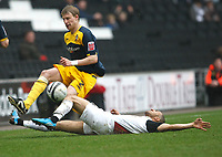 Photo: Steve Bond/Richard Lane Photography. MK Dons v Southampton. Coca-Cola Football League One. 20/03/2010. Dan Harding (L) is upended by Lewis Gobern