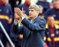 Arsene Wenger the Arsenal Manager claps the fans after the game. Bradford City 1:1 Arsenal, F.A. Carling Premiership, 9/9/2000. Credit Colorsport / Stuart MacFarlane.