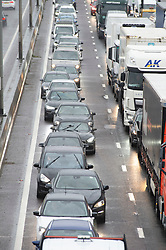 ©Licensed to London News Pictures 19/12/2019. <br /> Dartford ,UK. Bumper to bumper queuing. Wet weather and heavy traffic on the M25 near Dartford in Kent this afternoon as people make an early getaway for the Christmas holiday season.  Photo credit: Grant Falvey/LNP