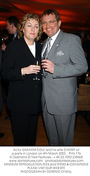 Actor GRAHAM COLE and his wife CHERRY at a party in London on 4th March 2003.PHN 176
