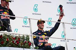 Race winner Daniel Ricciardo (AUS) Red Bull Racing celebrates on the podium with his race boot.<br /> 02.10.2016. Formula 1 World Championship, Rd 16, Malaysian Grand Prix, Sepang, Malaysia, Sunday.<br />  Copyright: Bearne / XPB Images / action press