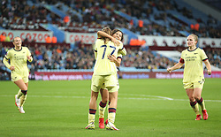 Arsenal's Mana Iwabuchi (centre right) celebrates with Tobin Heath (centre left) after scoring her sides second goal of the game during the FA Women's Super League match at Villa Park, Birmingham. Picture date: Saturday October 2, 2021.