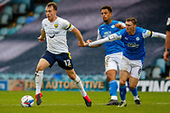 Oxford United defender Sam Long (12) gets ahead of Peterborough Utd Midfielder Jack Taylor (8) during the EFL Sky Bet League 1 match between Peterborough United and Oxford United at London Road, Peterborough, England on 17 October 2020.