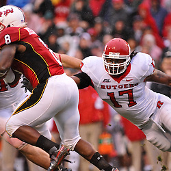 Sep 26, 2009; College Park, MD, USA; Maryland running back Davin Meggett (8) runs past the reach of Rutgers linebacker Damaso Munoz (17) during the second half of Rutgers' 34-13 victory over Maryland in NCAA college football at Byrd Stadium.