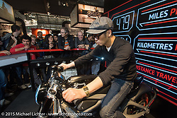 """Tad"" Tadashi Kono of Japan tries out the Harley-Davidson Live Wire electric bike at EICMA, the largest international motorcycle exhibition in the world. Milan, Italy. November 20, 2015.  Photography ©2015 Michael Lichter."