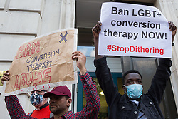 Campaigners against LGBT+ conversion therapy attend a picket outside the Cabinet Office and Government Equalities Office on 23rd June 2021 in London, United Kingdom. Represented by LGBT+ and human rights campaigner Peter Tatchell, Revd Colin Coward and Jayne Ozanne of the Ban Conversion Therapy Coalition, the campaigners also handed in a petition signed by 7,500 people calling on the government to fulfil its promise made in July 2018 to ban LGBT+ conversion therapy. LGBT+ conversion treatments, which have been linked to anxiety, depression and self-harm, have been condemned by major UK medical, psychological and counselling organisations.