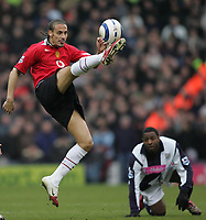 Photo: Lee Earle.<br /> West Bromwich Albion v Manchester United. The Barclays Premiership. 18/03/2006. United's Rio Ferdinand (L) clears the ball.
