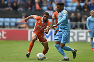 Shrewsbury Town defender Scott Golbourne (23) battles for possession  with Coventry City defender (on loan from Chelsea) Dujon Sterling (17) during the EFL Sky Bet League 1 match between Coventry City and Shrewsbury Town at the Ricoh Arena, Coventry, England on 28 April 2019.