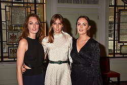 Left to right, Lady Violet Manners, Lady Alice Manners and Lady Eliza Manners daughters of the 11th Duke of Rutland at a party to celebrate the publication of Resolution by The Duke of Rutland and Emma Ellis held at Trinity House, Tower Hill, London England. 10 April 2017.