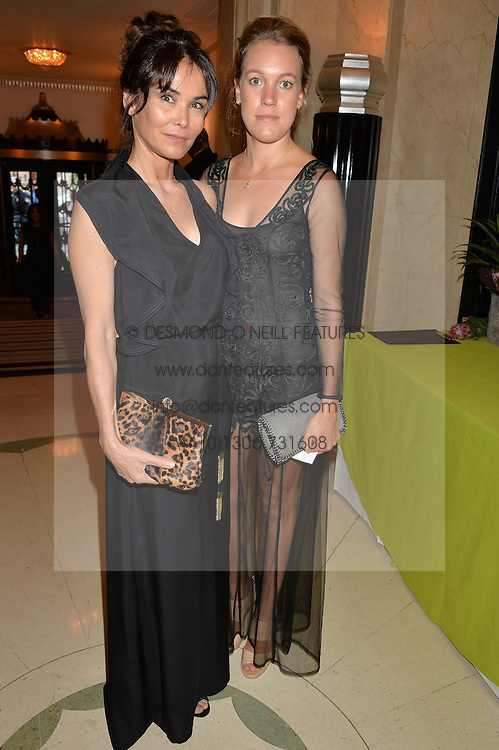Left to right, CINDY BILTON and the HON.EMILY PEARSON at the QBF Spring Gala in aid of the Red Cross War Memorial Children's Hospital hosted by Heather Kerzner and Jeanette Calliva at Claridge's, Brook Street, London on 12th May 2015.