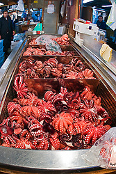 boilded octopi for sale at wholesale shop, Tsukiji Fish Market or Tokyo Metropolitan Central Wholesale Market, the world's largest fish market, hadling over 2,500 tons and over 400 different kind of fresh sea food per day