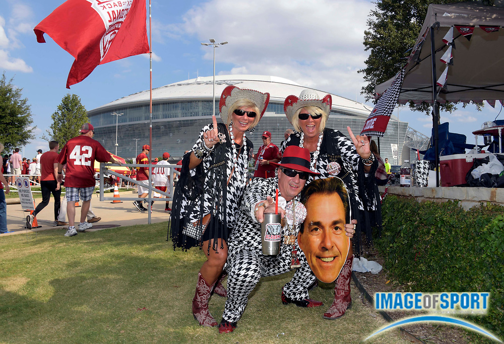 Sep 3, 2016; Arlington, TX, USA; Alabama Crimson Tide fans Donna Long (left) and Robin Albano (middle) and Debbie Albano (right) before the game against the USC Trojans before the game at AT&T Stadium.