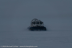 A fan boat having fun in the snow as darkness approaches during the Baikal Mile Ice Speed Festival. Maksimiha, Siberia, Russia. Saturday, February 29, 2020. Photography ©2020 Michael Lichter.