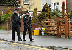 © Licensed to London News Pictures. 28/01/2013. Bristol, UK. Police pass flowers left at the scene where two cyclists, husband and wife Ross and Clare Simons, died after they were involved in a hit and run accident yesterday (27 January) with a vehicle in Lower Hanham Road, Hanham, Bristol.  The police have said they tried to flag the vehicle down before the accident because it was going at speed.  28 January 2013..Photo credit : Simon Chapman/LNP