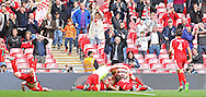 North Shields players celebrate going 2-1 up during the FA Vase Final between Glossop North End and North Shields at Wembley Stadium, London, England on 9 May 2015. Photo by Phil Duncan.