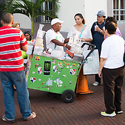 A street vendor selling flavored shaved ice refreshments to tourists in Casco Viejo, the historic old town of Panama City, Panama.