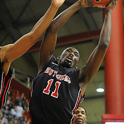 Rutgers Scarlet Knights guard/forward Dane Miller (11) grabs a defensive rebound during Rutgers' 67-60 upset victory over #8 UConn in NCAA Big East Basketball action at the Louis Brown Athletic Center in Piscataway, N.J. on Jan 7, 2012.