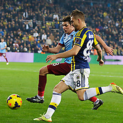 Fenerbahce's Caner Erkin (R) and Trabzonspor's Salih Dursun (L) during their Turkish superleague soccer derby Fenerbahce between Trabzonspor at the Sukru Saracaoglu stadium in Istanbul Turkey on Saturday 07 February 2015. Photo by Aykut AKICI/TURKPIX