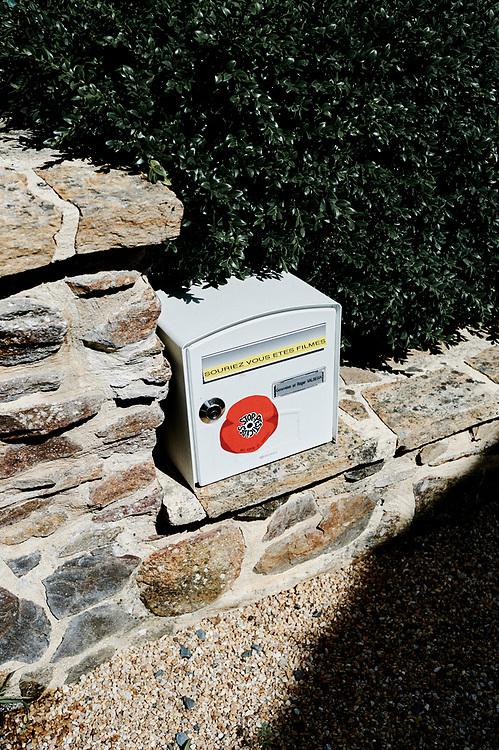 "A ""Stop Pesticides"" sticker on a letter box in the village. Saint-Pierre-de-Frugie, France. July 12, 2019."
