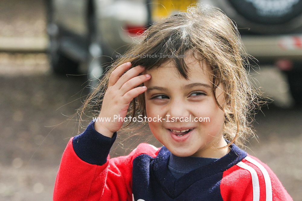 Portrait of a young smiling 4 year old girl. Model release available