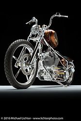 Bobby Seeger of Indian Larry Motorcycle's copper and gold custom. Photographed by Michael Lichter in Sturgis, SD on August 4, 2016. ©2016 Michael Lichter.