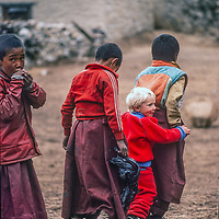 3-year old Ben Wiltsie joins in play with young Tibetan Buddhist monks at Tenboche Monastery in Nepal.