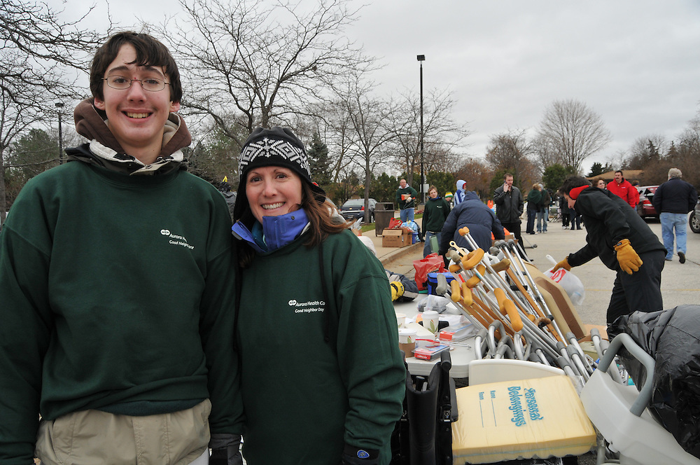Andrew Stiles and Kim Welch, the Aurora senior vice president of Corporate Affairs during Good Neighbor Day, Saturday Nov. 15 2008.  The program at this site was organized by Andrew Stiles, a boy scout, age 16, who has been diagnosed with muscular dystrophy, a disease that causes progressive muscle weakness.