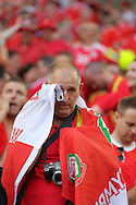 A Welsh fan can't hide his emotion as he sheds a tear at the final whistle after Wales win their first Euro 2016 match 2-1. Euro 2016, Wales v Slovakia at Matmut Atlantique , Nouveau Stade de Bordeaux  in Bordeaux, France on Saturday 11th June 2016, pic by  Andrew Orchard, Andrew Orchard sports photography.