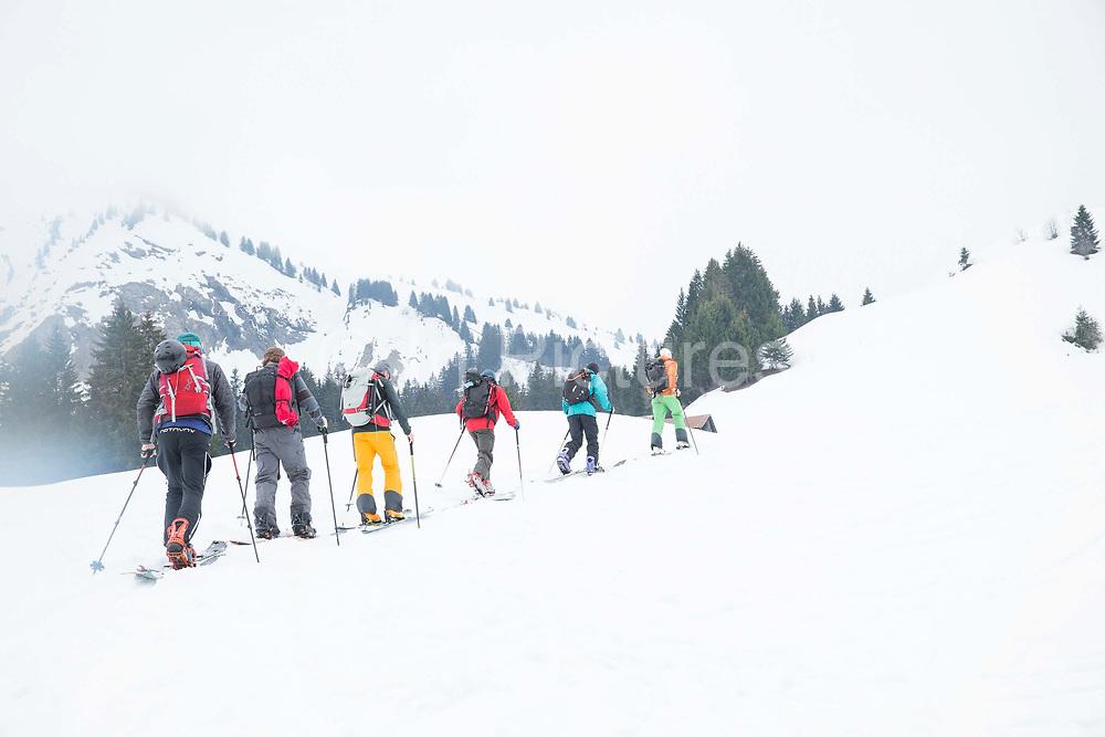 A splitboarding group skin up the Vallée De La Manche in Morzine / Portes du Soleil ski area on 21st March 2017 in France