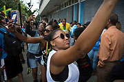A selfie on Monday 28th August 2016 at the 50th Notting Hill Carnival in West London. A celebration of West Indian / Caribbean culture and Europes largest street party, festival and parade. Revellers come in their hundreds of thousands to have fun, dance, drink and let go in the brilliant atmosphere. It is led by members of the West Indian / Caribbean community, particularly the Trinidadian and Tobagonian British population, many of whom have lived in the area since the 1950s. The carnival has attracted up to 2 million people in the past and centres around a parade of floats, dancers and sound systems.