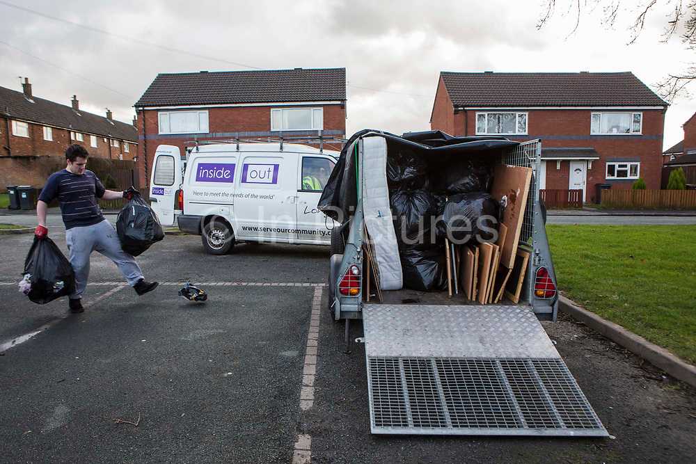 A volunteer from Longton Community Church working on rubbish removal from a house to improve the lives of those in need in their local community, Leyland, Lancashire.
