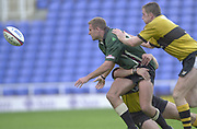 Reading, Berkshire, 29/09/02<br /> London Irish vs Wasps,<br /> Exiles Geoff Appleford, tackled, but gets his pass  away, during the ZURICH PREMIERSHIP RUGBY match at the Madejski Stadium,  [Mandatory Credit: Peter Spurrier/Intersport Images],
