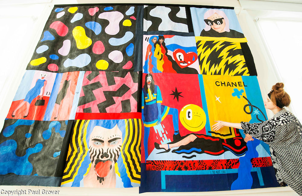 London based,Colchester Born artist/illustrator Hattie Stewart with her work at The House of Illustration at King's Cross for her exhibition On 17 April 2015 Hattie Stewart: Adversary. This is a new body of work from the self-proclaimed professional 'doodle-bomber', in which Stewart takes on glossy advertising imagery with her characteristic homage-meets-satire approach.<br /> Hattie Stewart: Adversary is the first in House of Illustration's series of illustrator commissions – new work from contemporary illustrators to be shown in House of Illustration's South Gallery.Pic Shows Hattie with 'Head over heels' one of her tapestry's