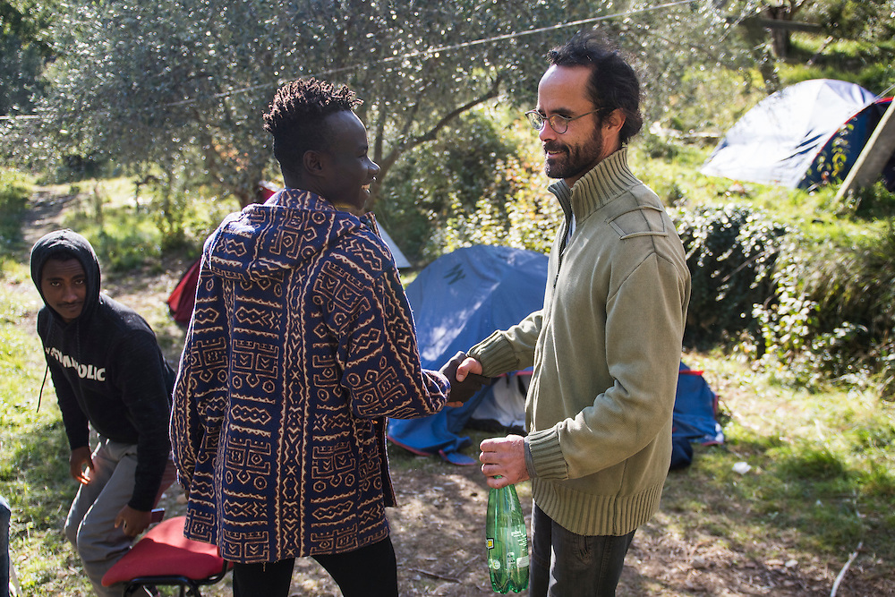 November 8, 2016 - Breil-sur-Roya, France: Cedric Herrou, a 37-year-old farmer, with a migrant from Chad he houses on his farm. Cedric is one of the 120 inhabitants of the village Breil-sur-Roya in the Roya valley, in the Alps on the French Italian border, who formed a clandestine network to help migrants who walked into the valley from Ventimiglia, Italy, with shelter, food and transportation.<br /> <br /> 8 novembre 2016 - Breil-sur-Roya, France: Cedric Herrou, agriculteur de 37 ans, avec un migrant tchadien de 18 ans qu'il loge chez lui. Cédric est l'un des 120 habitants du village de Breil-sur-Roya dans la vallée de la Roya, à la frontière italienne, qui aident des migrants.