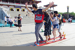 May 30, 2017 - Xi'An, Xi'an, China - Xi'an, CHINA-May 30 2017: (EDITORIAL USE ONLY. CHINA OUT) Visitors attend the 'dragon boat racing' on land in Xi'an, northwest China's Shaanxi Province, May 30th, 2017, marking Dragon Boat Festival. (Credit Image: © SIPA Asia via ZUMA Wire)