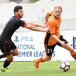 BRISBANE, AUSTRALIA - DECEMBER 10: Kye Rowles of the Roar dribbles the ball under pressure from Alec Maiolo of Adelaide United during the round 5 Foxtel National Youth League match between the Brisbane Roar and Adelaide United at AJ Kelly Field on December 10, 2016 in Brisbane, Australia. (Photo by Patrick Kearney/Brisbane Roar)