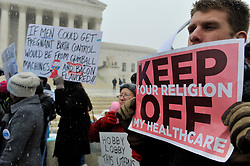 March 25, 2014 - Washington, DC, U.S. - Supporters of ''Obamacare'' and women's reproductive rights rally in front of the U.S. Supreme Court as the court hears twin challenges to the healthcare law.  The cases, brought by two corporations, Hobby Lobby and Conestoga Wood Specialties, challenge a provision of the Affordable Care Act that requires many employers to provide female workers with comprehensive insurance coverage for a variety of methods of contraception. (Credit Image: © Jay Mallin/ZUMAPRESS.com)