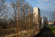 Fenced off waste ground in Balsall Heath near social housing estate high rise tower block in Highgate on 7th January 2021 in Birmingham, United Kingdom. Following the Big City Plan of February 2008, Highgate is now a district of Birmingham City Centre, yet is a very poor area of housing estates, lacking in investment.